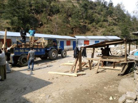 Delivery of building materials at school in Shivalaya